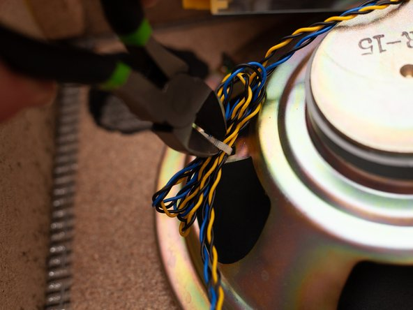 Use wire cutters to remove the zip tie fastening the wires to the speaker.
