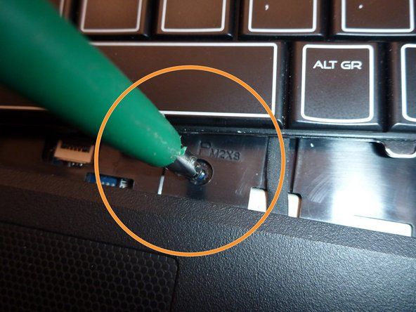 Image 2/3: Second one at bottom near the touchpad,