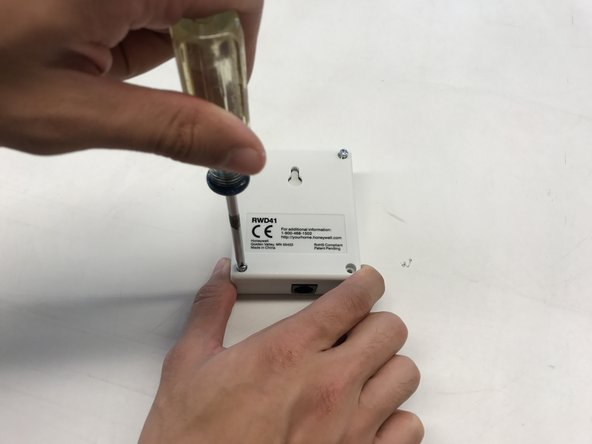 Image 1/3: The circuit board slides off of plastic standoffs for closer inspection