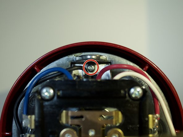 Using a Phillips #1 screwdriver, remove the 9.5mm screw above the circuit board by rotating it counterclockwise.