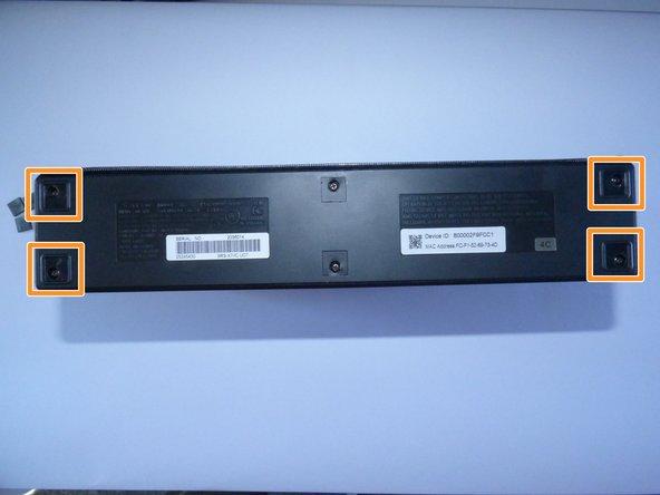 Image 2/2: Unscrew the 4 10mm Philips J1 screws beneath them.
