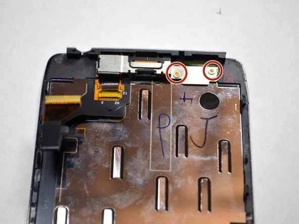 Remove the two 2.0mm T4 Torx screws near the top of the screen.