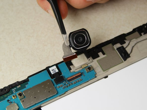 Pull the connector out of the slot using tweezers and remove the camera.