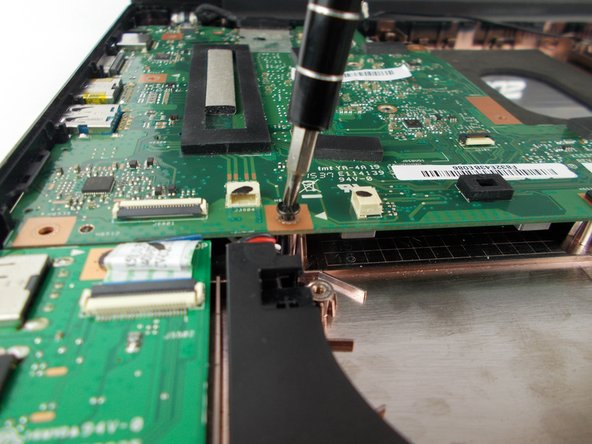 Remove the Phillips #0 screws securing the motherboard to laptop.