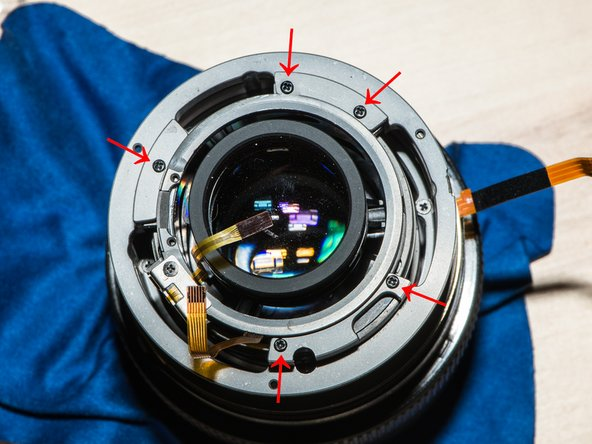 Drop the focus assembly onto the main lens module. Be careful with the ribbon cables.