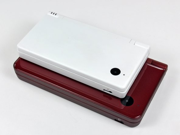 Image 1/3: Side by side comparison of the DSi (left) and DSi XL (right).