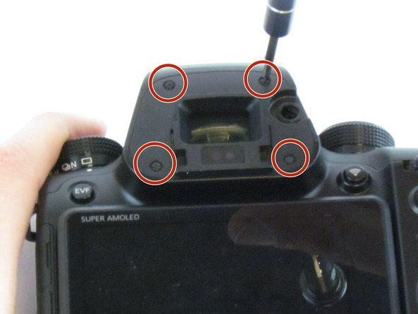 Use the Phillips #00 screwdriver to remove the four 5.5 mm screws surrounding the viewfinder.