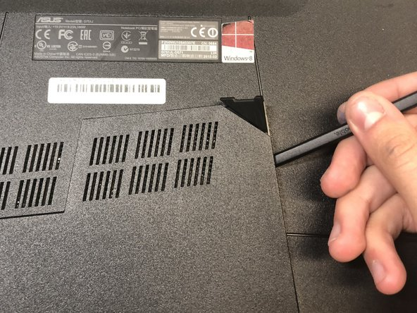 Use the standard spudger to remove the back center panel.