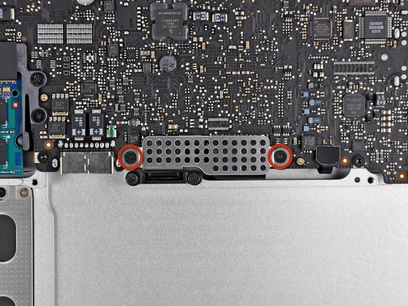 Image 1/2: Remove the EMI shield from the logic board.