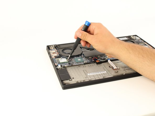 Using a Phillips #00 head screwdriver, remove the 3mm screw holding the wireless adapter to the motherboard.