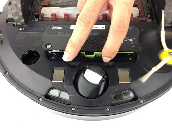 Lift the plastic cover to access the battery.