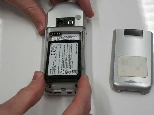 To remove the battery, first grab it using a finger on either side.