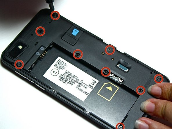Use a Torx 4 screwdriver to remove the nine screws around the battery.