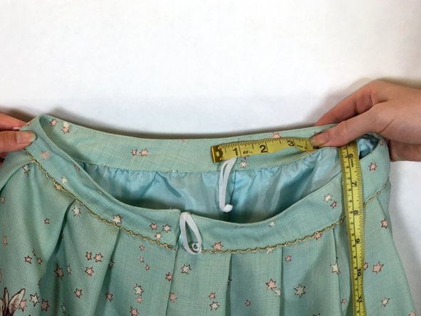 Using a pin, mark the length of your measurement on either side of the side seam.