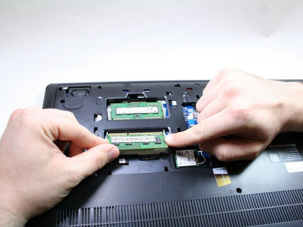 Gently remove the RAM stick once it has popped out of its place.