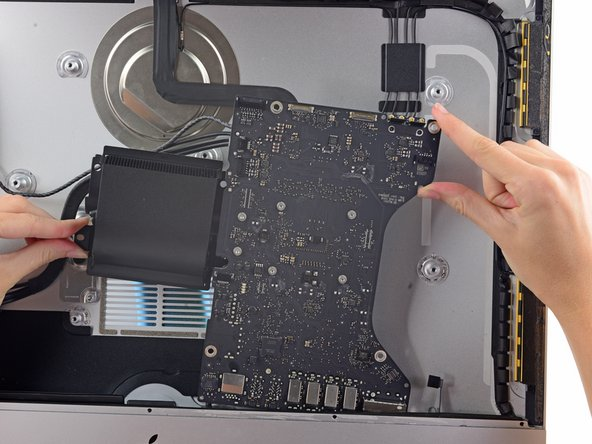 Lift the logic board straight up and out of the iMac.