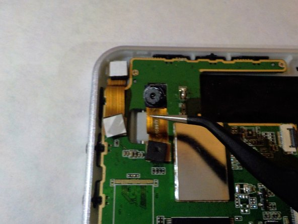 Image 1/3: The bottom half of the camera strip will pop out.