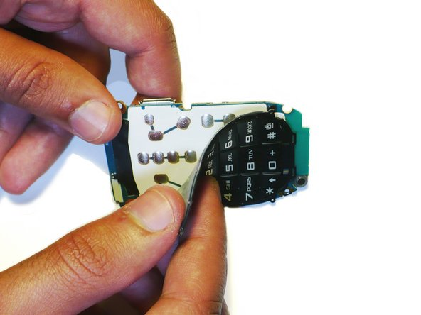 The keypad should peel off the logic board with a gentle pull.