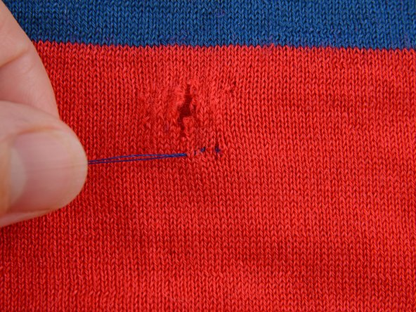 Pull the needle through until the thread is taut, but not pulling or scrunching the fabric.
