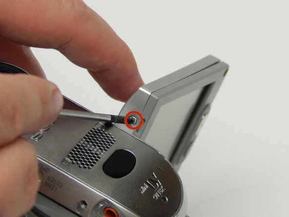 Image 2/3: Spin the LCD screen around to get the 5 MM Phillips #1 screw in the same place on the other side.