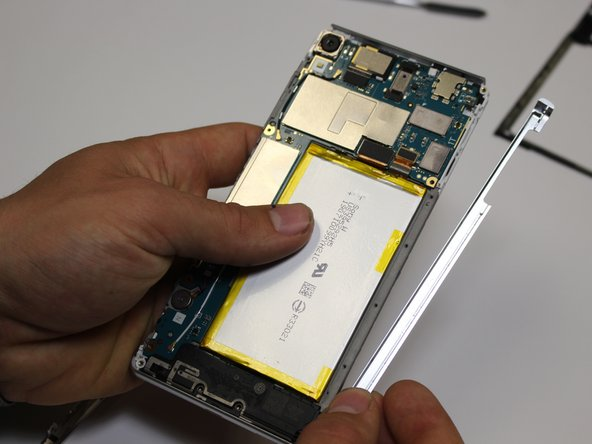 Remove the side bezels from each side, and remove the sim card cover.