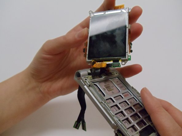 Image 2/2: Pull the screen up and away from the case.