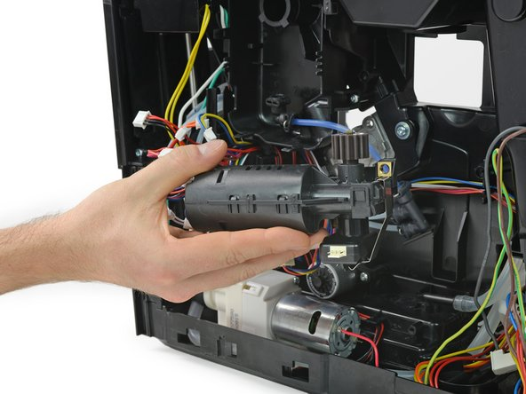 The gear motor with its encoder attached is fixed with only two Torx screws.
