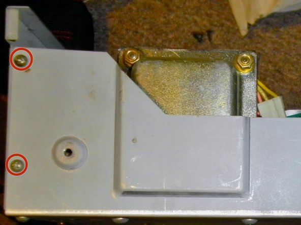 Once the main casing is removed, you'll need to remove the back panel. Keep the amplifier on its side and remove the two, Phillips #1 screws holding it on, on both sides of the amplifier.