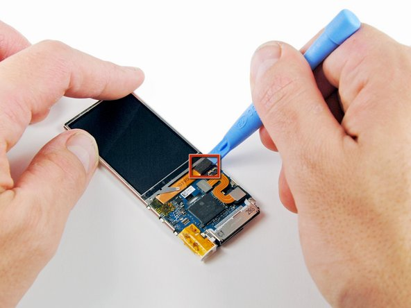 Use an iPod opening tool to pry the display connector off its socket on the logic board.