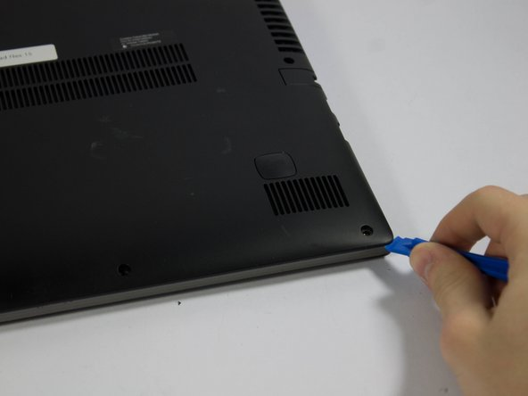 There is a visible line between the bottom shell of the laptop and the laptop body itself.