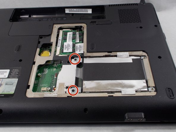 Unscrew and remove the 2 circled screws. Set these screws aside, but keep them separate from the cover plate screws.