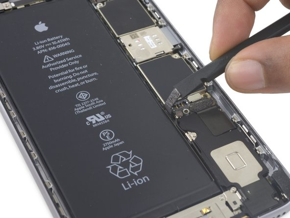 Bend the connector back to ensure it doesn't make contact and power the iPhone on while you're working on it.