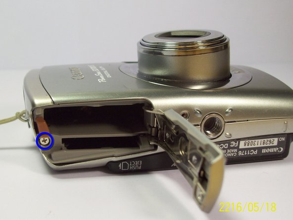 Remove the screws on the bottom of the camera near the battery and the memory card slots.