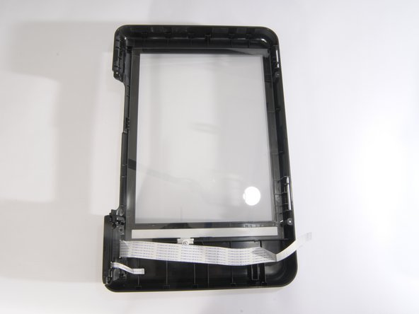 The LCD screen is attached to the piece of the hood with the glass shield.