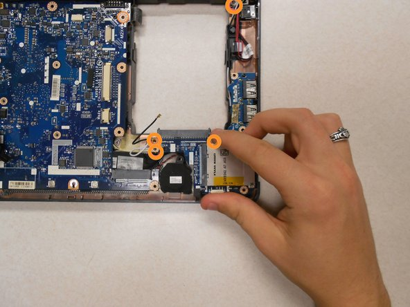 Using a Philllips #00 screwdriver, remove the four (4) 5mm screws holding the motherboard in place.