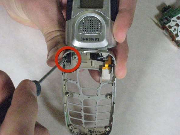Remove the hinge on the phone.