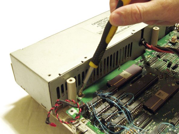 Remove the screws holding the power supply in place and unclip the connector from the main board.