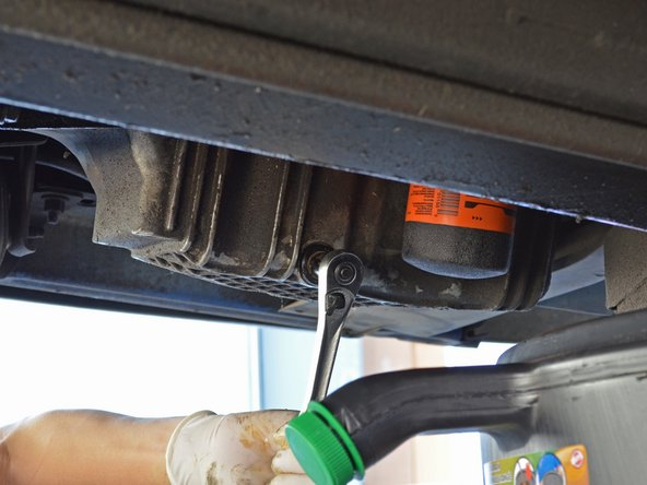 Only tighten the drain plug until it is snug. Over-tightening the oil drain plug can strip or crack the oil pan—a very costly error. You can always tighten the drain plug more later.