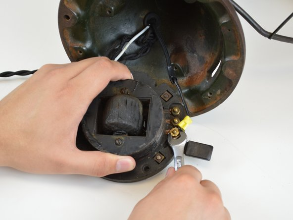 Turn the switch over and unscrew the nut securing the wire with the 5/16 crescent wrench.