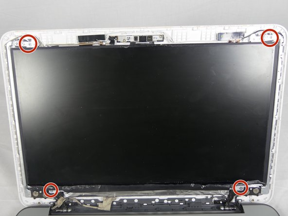 Once the bezel has been removed, remove the four 5mm screws at the corners of the screen using a PH00 screwdriver.
