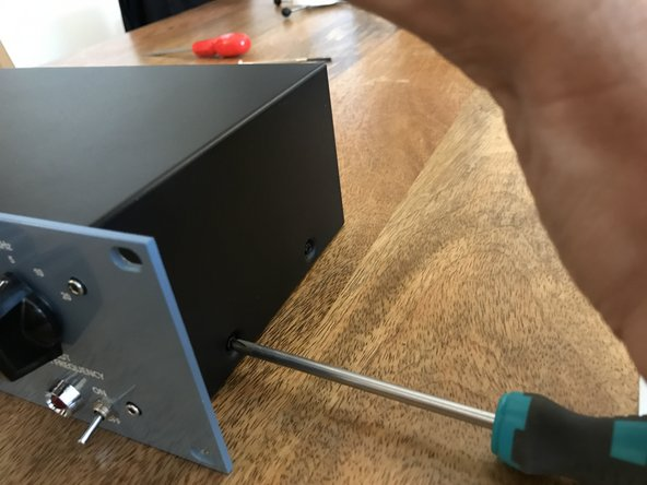 Remove the screws at the top, sides and back of the unit with a standard phillips screwdriver.