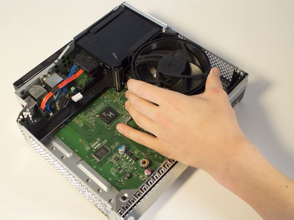 Flip the Xbox over and take out the heat sink plastic shield.