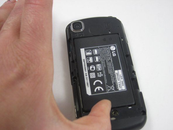 Push the battery out by pushing from the end furthest from the camera.
