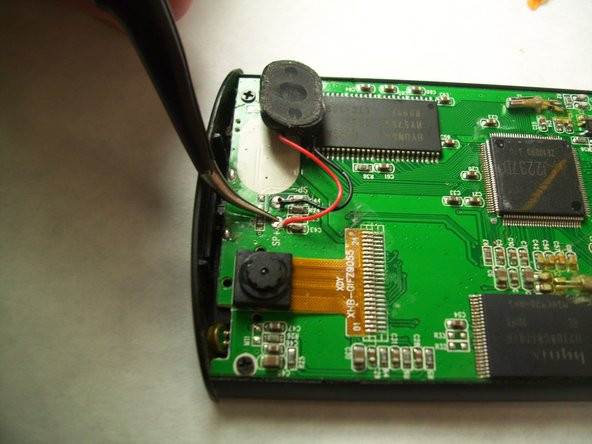 Use the soldering guide to desolder the speaker contacts.