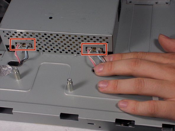 Remove the 4 connectors from the left side of the monitor on the back.