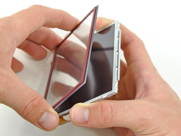 With three sides freed, remove the touchscreen from the lower display.