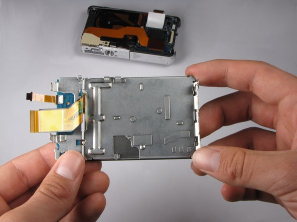 Pull the LCD and its casing away from the rest of the camera.