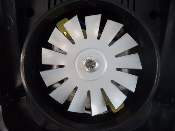 Loosen the washer with a flathead screwdriver, then remove the fan and replace with a new one.