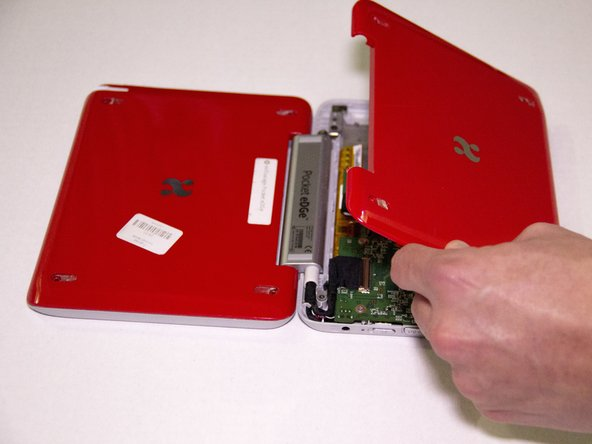 Using the plastic opening tool, lift the back plate from both sides of your device and remove them.