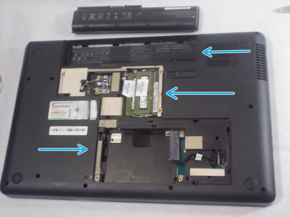 Take out the Battery and the placeholder for the RAM and the Hard Drive